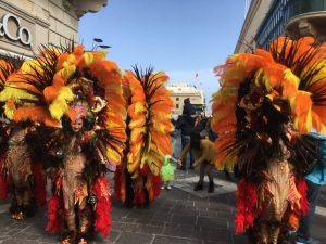 dancers in giant flowered headdresses, and not much else