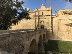 Stone bridge over the dry moat and walls of the city of Mdina